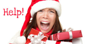 A picture of a woman with her mouth wide open like a scream wearing a santa hat surrounded by wrapped presents with the word help on the left